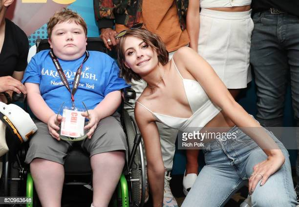 The cast of 'Arrow' with MakeAWish kids on the #IMDboat at San Diego ComicCon 2017 at The IMDb Yacht on July 22 2017 in San Diego California