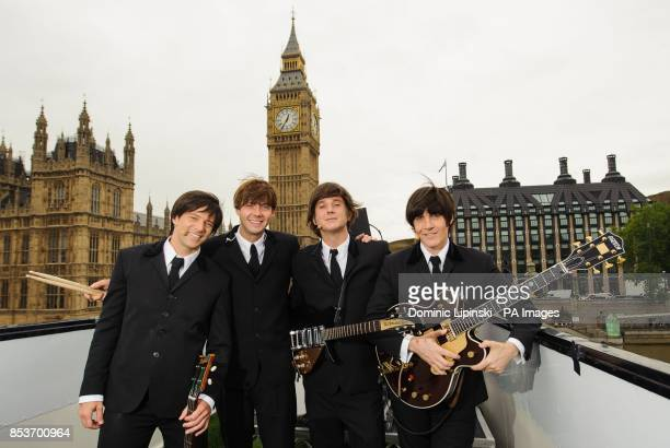 The cast of Beatles musical Let it Be James Fox Luke Roberts Paul Canning and John Brosnan perform on an open top bus in Trafalgar Square in central...