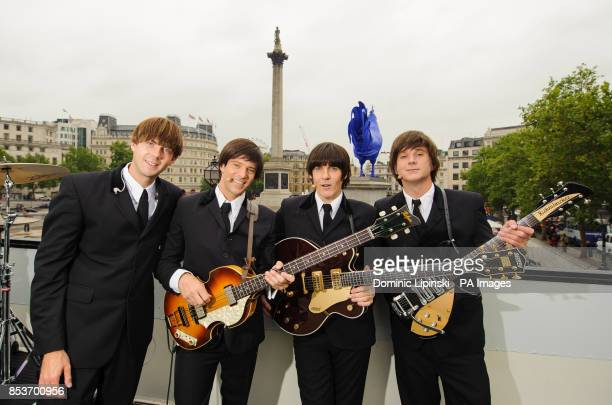 The cast of Beatles musical Let it Be Luke Roberts James Fox John Brosnan and Paul Canning perform on an open top bus in Trafalgar Square in central...