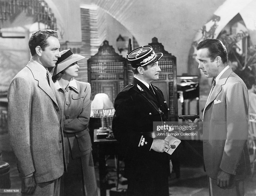 The cast of Casablanca (1942) from left to right: <a gi-track='captionPersonalityLinkClicked' href=/galleries/search?phrase=Paul+Henreid&family=editorial&specificpeople=92297 ng-click='$event.stopPropagation()'>Paul Henreid</a> as Victor Laszlo, <a gi-track='captionPersonalityLinkClicked' href=/galleries/search?phrase=Ingrid+Bergman&family=editorial&specificpeople=70003 ng-click='$event.stopPropagation()'>Ingrid Bergman</a> as Ilsa Lund Laszlo, <a gi-track='captionPersonalityLinkClicked' href=/galleries/search?phrase=Claude+Rains&family=editorial&specificpeople=228466 ng-click='$event.stopPropagation()'>Claude Rains</a> as Captain Louis Renault, and <a gi-track='captionPersonalityLinkClicked' href=/galleries/search?phrase=Humphrey+Bogart&family=editorial&specificpeople=70004 ng-click='$event.stopPropagation()'>Humphrey Bogart</a> as Rick Blaine.