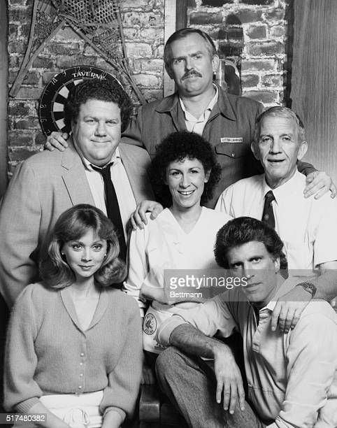 The cast of Cheers pose together in character From left to right starting with the front row are Shelly Long as bartender Diane Chambers Ted Danson...