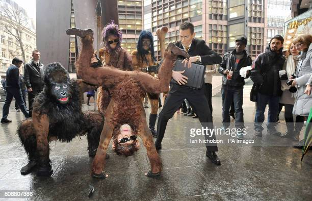 The cast of Cirque du Soleil's new show Totem recreate Darwin's iconic evolution of man scene to shoppers and office workers at London's Liverpool...