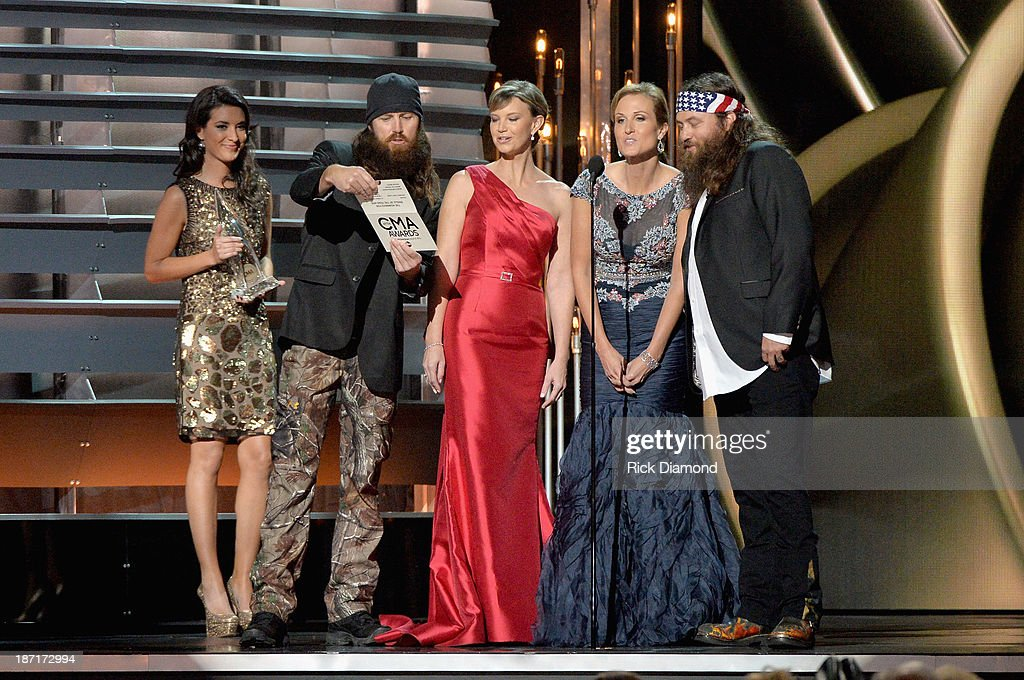 The cast of Duck Dynasty speaks onstage during the 47th annual CMA Awards at the Bridgestone Arena on November 6, 2013 in Nashville, Tennessee.
