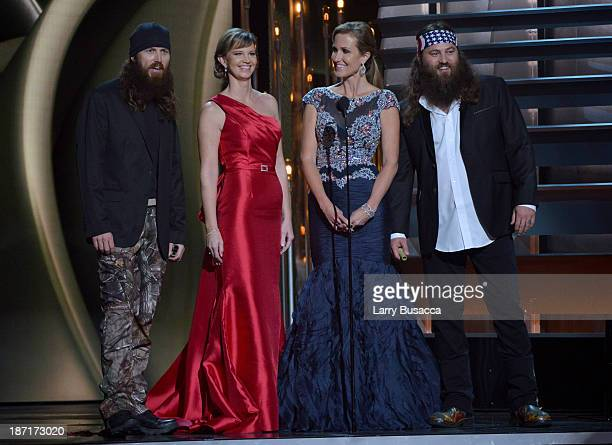 The cast of Duck Dynasty speaks onstage during the 47th annual CMA Awards at the Bridgestone Arena on November 6 2013 in Nashville Tennessee