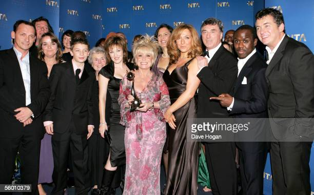 The cast of 'Eastenders' including Barbara Windsor Kacey Ainsworth and TraceyAnn Oberman pose in the awards room with the Serial Drama Award for...