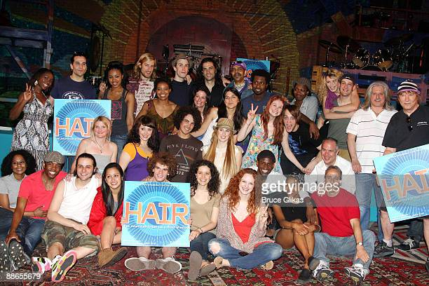 The cast of 'Hair' poses at the cast recording signing of 'HAIR The American Tribal LoveRock Musical' on stage at the Al Hirschfeld Theatre on June...