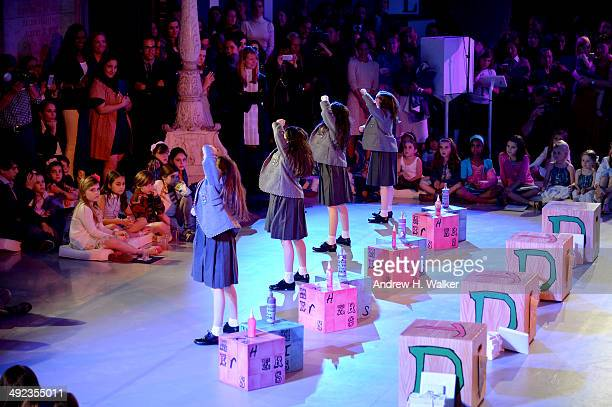 The cast of Matilda perform at the Ralph Lauren Fall 14 Children's Fashion Show in Support of Literacy at New York Public Library on May 19 2014 in...