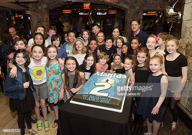 The cast of Matilda pose at the 'Matilda' On Broadway Second Anniversary Celebration at Bowlmor Lanes Times Square on April 12 2015 in New York City