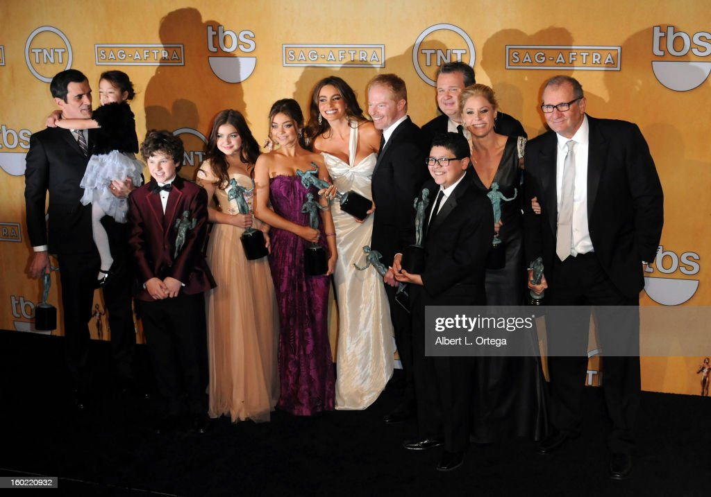 The cast of 'Modern Family' (L-R) Actors Ty Burrell, Aubrey Anderson-Emmons, Nolan Gould, Ariel Winter, Sarah Hyland, Sofia Vergara, Jesse Tyler Ferguson, Eric Stonestreet, Rico Rodriguez, Julie Bowenpose and Ed O'Neill in the press room at the 19th Annual Screen Actors Guild Awards held at The Shrine Auditorium on January 27, 2013 in Los Angeles, California.