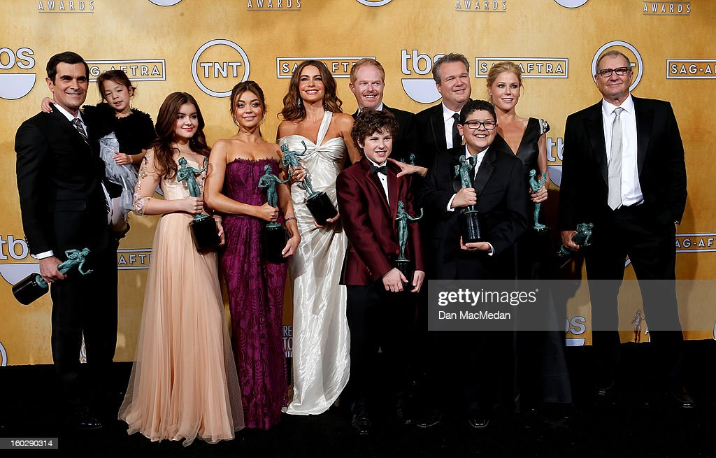 The cast of 'Modern Family' (L-R) actors Ty Burrell, Aubrey Anderson-Emmons, Nolan Gould, Ariel Winter, <a gi-track='captionPersonalityLinkClicked' href=/galleries/search?phrase=Sarah+Hyland&family=editorial&specificpeople=3989646 ng-click='$event.stopPropagation()'>Sarah Hyland</a>, <a gi-track='captionPersonalityLinkClicked' href=/galleries/search?phrase=Sofia+Vergara&family=editorial&specificpeople=214702 ng-click='$event.stopPropagation()'>Sofia Vergara</a>, Jesse Tyler Ferguson, Eric Stonestreet, Rico Rodriguez, Julie Bowenpose and Ed O'Neill pose with the award for Outstanding Performance by an Ensemble in a Comedy Series in the press room at the 19th Annual Screen Actors Guild Awards at the Shrine Auditorium on January 27, 2013 in Los Angeles, California.
