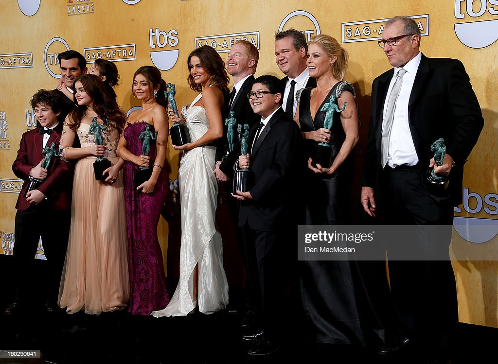 The cast of 'Modern Family' (L-R) actors Ty Burrell, Aubrey Anderson-Emmons, Nolan Gould, Ariel Winter, Sarah Hyland, Sofia Vergara, Jesse Tyler Ferguson, Eric Stonestreet, Rico Rodriguez, Julie Bowenpose and Ed O'Neill pose with the award for Outstanding Performance by an Ensemble in a Comedy Series in the press room at the 19th Annual Screen Actors Guild Awards at the Shrine Auditorium on January 27, 2013 in Los Angeles, California.