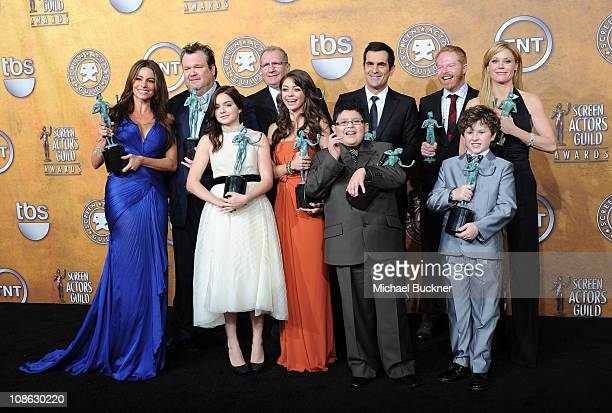 The cast of Modern Family poses in the press room at the TNT/TBS broadcast of the 17th Annual Screen Actors Guild Awards held at The Shrine...