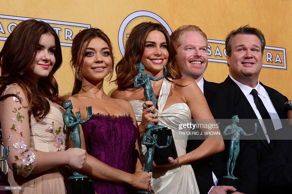 The cast of Modern Family poses with the Screen Actors Guild Award for for Oustanding Performance by an Ensemble in a Comedy Series in the press room at the Shrine Auditorium in Los Angeles on January 27, 2013. AFP PHOTO / Frederic J. BROWN
