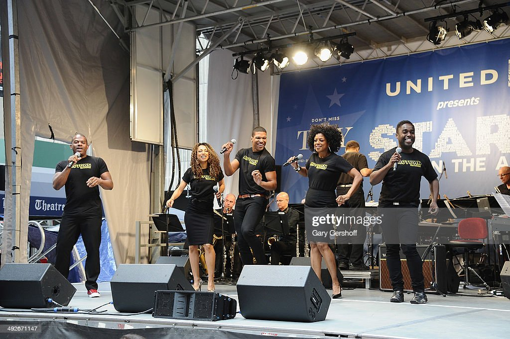 The cast of 'Motown The Musical' perform on stage during 'Stars In The Alley' at Shubert Alley on May 21 2014 in New York City