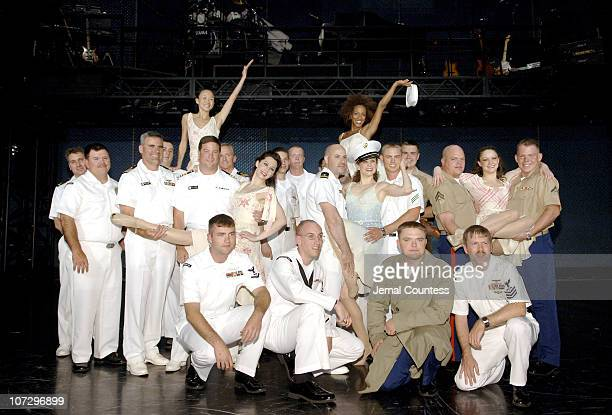 The Cast of Movin Out poses with Sailors of Carrier Air Wing 17 and a Marine Expeditionary Unit from the USS John F Kennedy