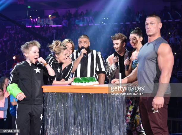 The cast of Nicky Ricky Dicky Dawn armwrestle with host John Cena onstage with Dj Khaled at Nickelodeon's 2017 Kids' Choice Awards at USC Galen...