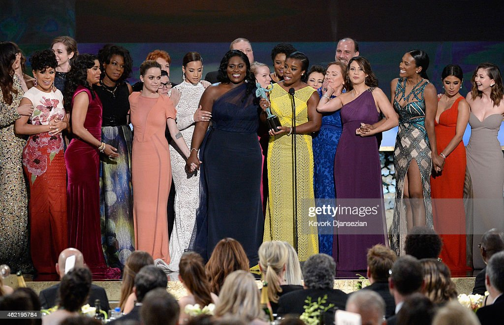 The cast of Orange Is The New Black accepts the award for Outstanding Performance by an Ensemble in a Comedy Series onstage at the 21st Annual Screen...