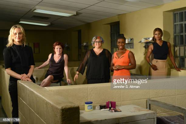 The cast of Orange is the New Black Taylor Schilling Kate Mulgrew creator Jenji Kohan Uzo Aduba and Laverne Cox are photographed for Los Angeles...