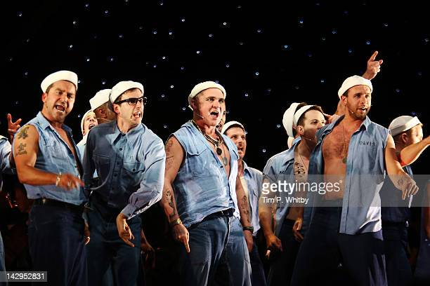 The cast of South Pacific perform onstage at the 2012 Olivier Awards at The Royal Opera House on April 15 2012 in London England