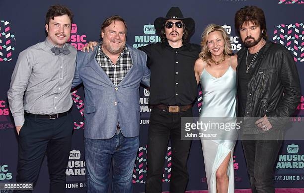 The cast of 'Still the King' Travis Nicholson Kevin Farley Jon Sewell Joey Lauren Adams and Billy Ray Cyrus attend the 2016 CMT Music awards at the...