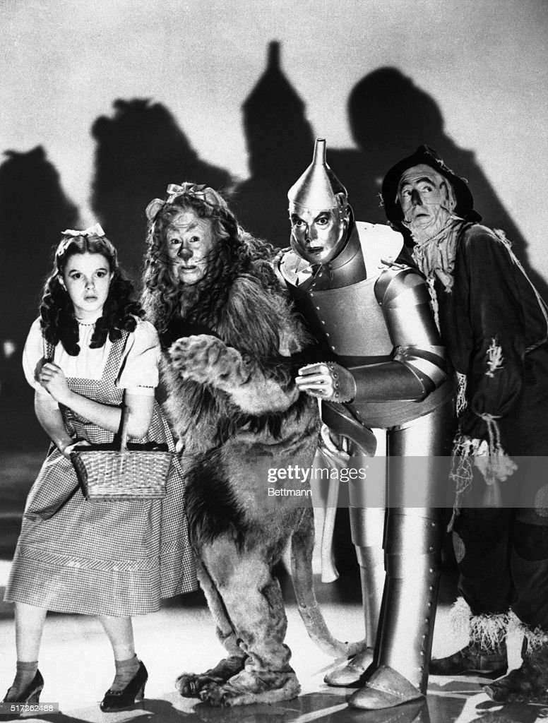 The cast of the 1939 MGM production of 'The Wizard of Oz' stand together during a scene from the movie From left to right are Judy Garland as Dorothy...