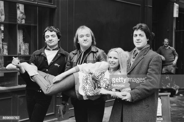 The cast of the BBC comedy satire 'Not The Nine O Clock News' Left to right are Rowan Atkinson Mel Smith and Griff Rhys Jones holding Pamela...