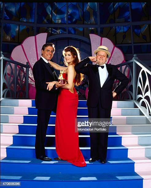 'The cast of the broadcast ''Scherzi a parte'' Teo Teocoli Pamela Prati and Massimo Boldi photographed on the stairs of the TV stage this program of...