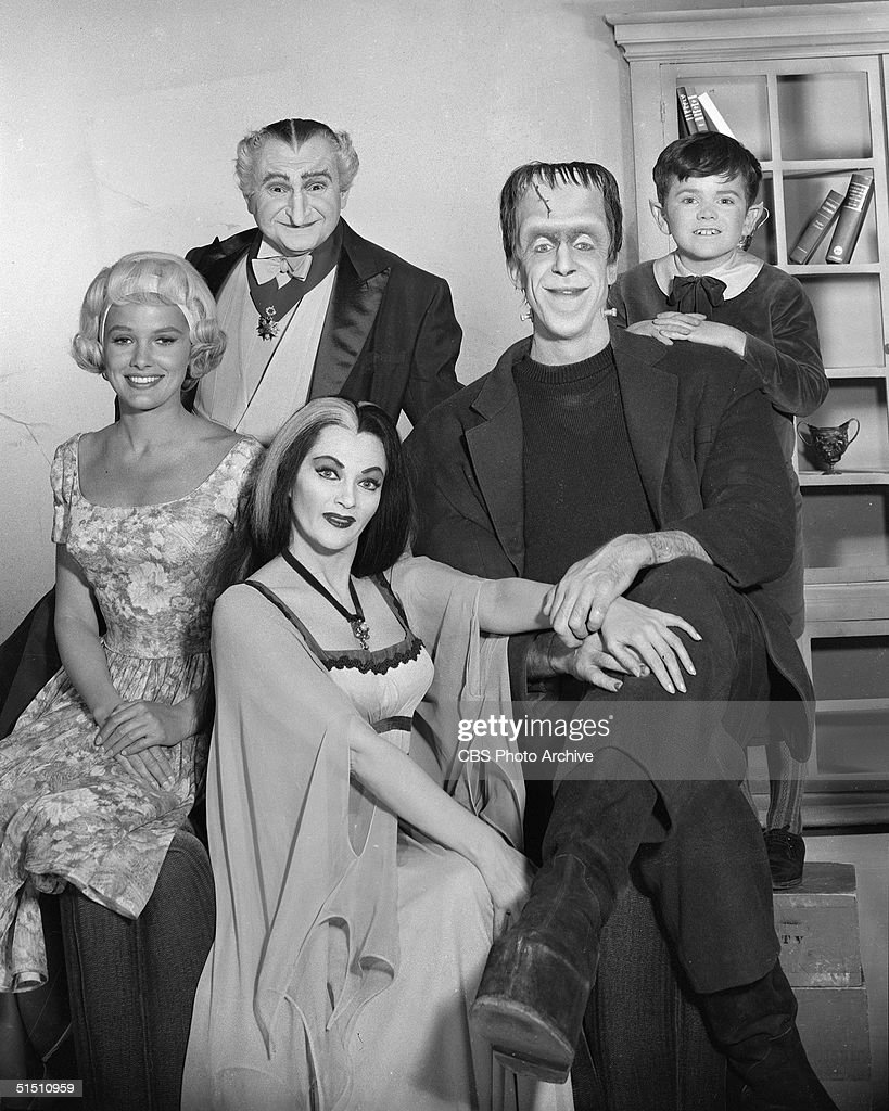 The cast of the CBS television situation comedy 'The Munsters' including (clockwise from top) American actor and political candidate Al Lewis (as Grandpa, a vampire), American actor and children's book author Fred Gwynne (1926 - 1993) (as Herman Munster, a moster created from human body parts), child actor Butch Patrick (as Eddie Munster, a werewolf), Canadian actress Yvonne de Carlo (as Lily Munster), and Beverly Owen (as Marilyn Munster), poses for a promotional portrait, May 5, 1964.