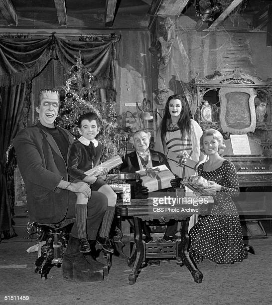 The cast of the CBS television situation comedy 'The Munsters' including American actor and children's book author Fred Gwynne child actor Butch...