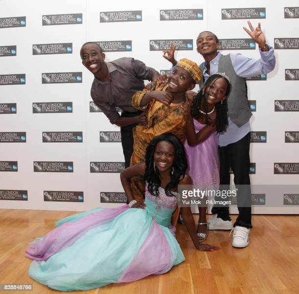 The cast of the film Africa United Roger Nsengiyumva Eriya Ndayambaje Sherrie Silver Sanyu Joanita Kintu and Yves Dusenge attend the premiere of...