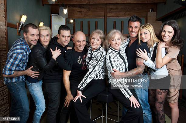 The cast of the film Good As You All the colors of love posing with the german dancers Alice and Ellen Kessler The cast consists of the Italian...