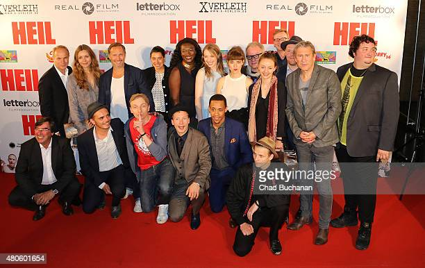 The cast of the film 'Heil' pose together at the German premiere of 'Heil' at Kino International on July 13 2015 in Berlin Germany