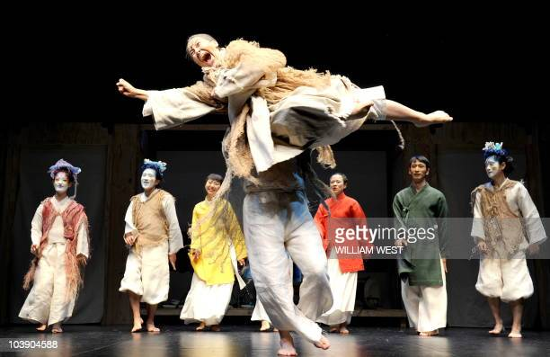 The cast of the Korean theatre company Yohangza performs Shakespeare's 'A Midsummer Night�s Dream' at a preview before the opening in Melbourne on...