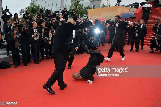 The cast of the movie 'Les Kaira' Franck Gastambide Ramzy Bediai Jib Pocthier and Mehdi Sadoun dance on the red carpet before for the screening of...