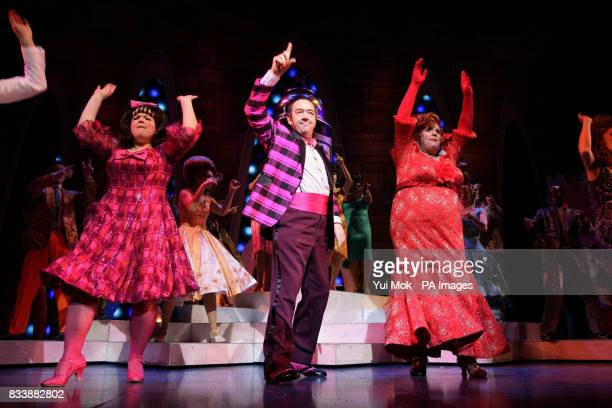 The cast of the musical 'Hairspray' including Leanne Jones Mel Smith and Michael Ball during a photocall at the Shaftesbury Theatre in central London