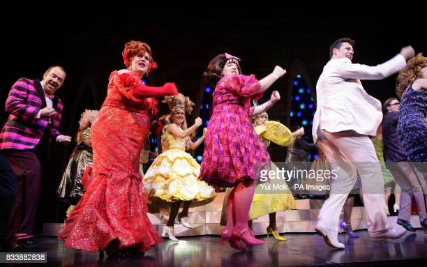 The cast of the musical 'Hairspray' including Mel Smith Michael Ball Leanne Jones and Ben JamesEllis during a photocall at the Shaftesbury Theatre in...