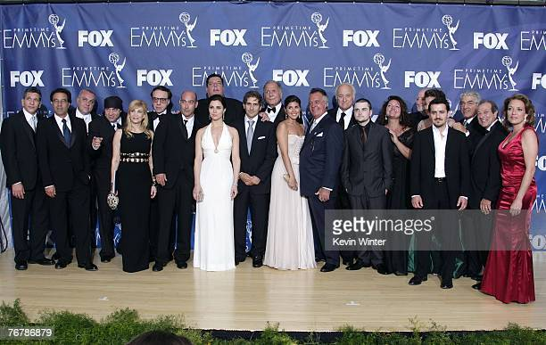 The cast of 'The Sopranos' poses in the pressroom after their win for 'Outstanding Drama Series' during the 59th Annual Primetime Emmy Awards at the...