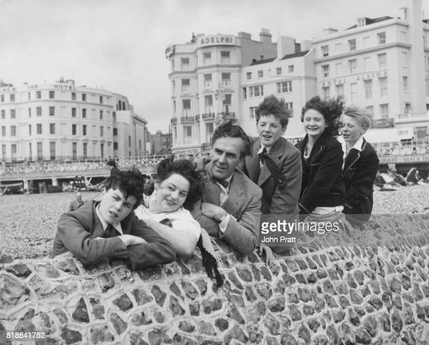 The cast of the television series 'Happy Holidays' filming by the sea at Brighton UK 1954 From left to right Colin Campbell Hattie Jacques John Le...
