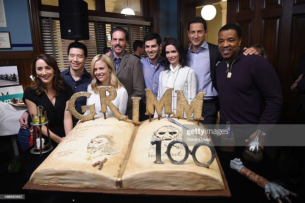 The cast of the TV series Grimm, <a gi-track='captionPersonalityLinkClicked' href=/galleries/search?phrase=Bree+Turner&family=editorial&specificpeople=233811 ng-click='$event.stopPropagation()'>Bree Turner</a>, Reggie Lee, <a gi-track='captionPersonalityLinkClicked' href=/galleries/search?phrase=Claire+Coffee&family=editorial&specificpeople=5407090 ng-click='$event.stopPropagation()'>Claire Coffee</a>, <a gi-track='captionPersonalityLinkClicked' href=/galleries/search?phrase=Silas+Weir+Mitchell&family=editorial&specificpeople=4195871 ng-click='$event.stopPropagation()'>Silas Weir Mitchell</a>, <a gi-track='captionPersonalityLinkClicked' href=/galleries/search?phrase=David+Giuntoli&family=editorial&specificpeople=8011911 ng-click='$event.stopPropagation()'>David Giuntoli</a>, <a gi-track='captionPersonalityLinkClicked' href=/galleries/search?phrase=Bitsie+Tulloch&family=editorial&specificpeople=4616199 ng-click='$event.stopPropagation()'>Bitsie Tulloch</a>, <a gi-track='captionPersonalityLinkClicked' href=/galleries/search?phrase=Sasha+Roiz&family=editorial&specificpeople=6685510 ng-click='$event.stopPropagation()'>Sasha Roiz</a> and <a gi-track='captionPersonalityLinkClicked' href=/galleries/search?phrase=Russell+Hornsby&family=editorial&specificpeople=546635 ng-click='$event.stopPropagation()'>Russell Hornsby</a> pose in front of a cake celebrating the 100th episode of the series on November 10, 2015 in Portland, Oregon.