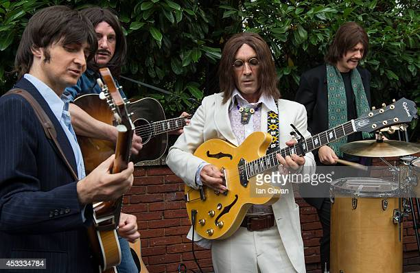 The cast of the West End Beatles show 'Let It Be' perform outside Abbey Road Studios during a photocall to celebrate The Beatles 45th Anniversary at...