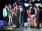 The cast of 'Twilight Saga New Moon' accepts the Best Movie award onstage at the 2010 MTV Movie Awards held at the Gibson Amphitheatre at Universal...