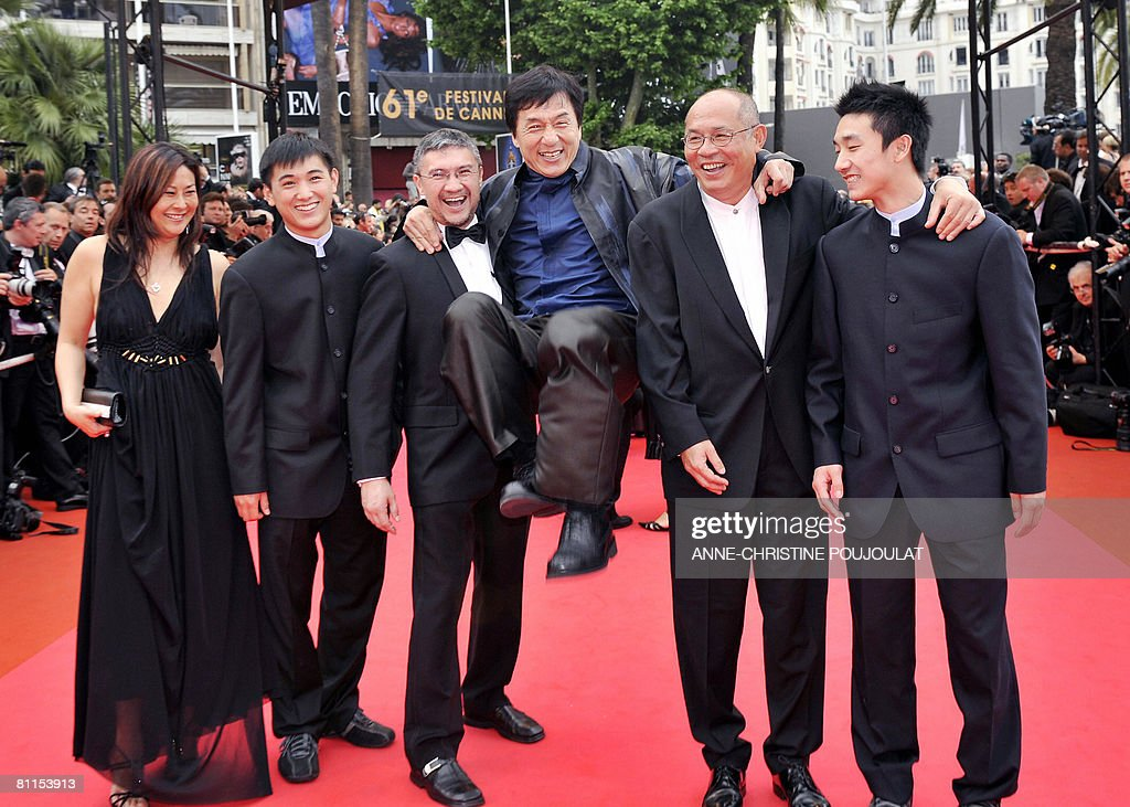 The cast of 'Wushu' (from L to R) Producer Colette Koo, actor Wang Wenjie, director Antony Szeto, actor Jackie Chan, producer John Sham and actor Liu Fengchao attend the screening of Belgian directors Jean-Pierre and Luc Dardenne's film 'Le Silence de Lorna' (Lorna's Silence) at the 61st Cannes International Film Festival on May 19, 2008 in Cannes, southern France. The May 14-25 festival winds up with the awards ceremony for the prestigious Palme d'Or, to be determined by a jury headed by Hollywood 'bad boy' Sean Penn. AFP PHOTO / Anne-Christine Poujoulat