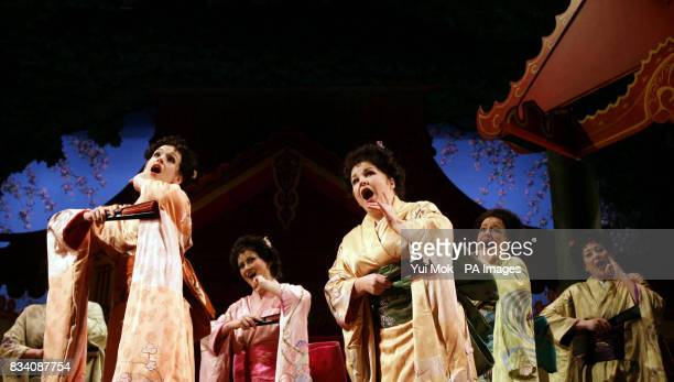 The cast on stage during a dress rehearsal for The Mikado at The Gielgud Theatre in central London