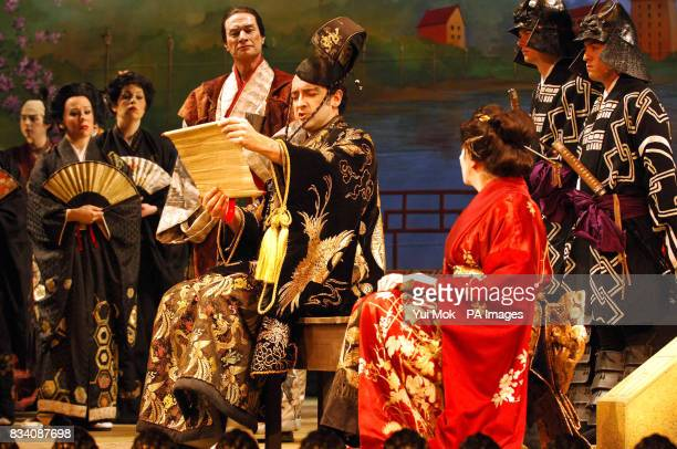 The cast on stage including Alistair McGowan as The Mikado of Japan and Nichola McAuliffe as Katisha during a dress rehearsal for The Mikado at The...