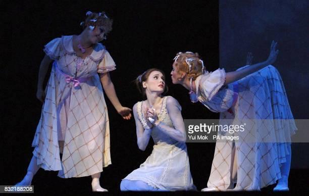 The cast rehearsing on stage including Svetlana Zakharova as Cinderella and Anastasia Vinokur and Lolo Kochetkova as her Stepsisters during a...