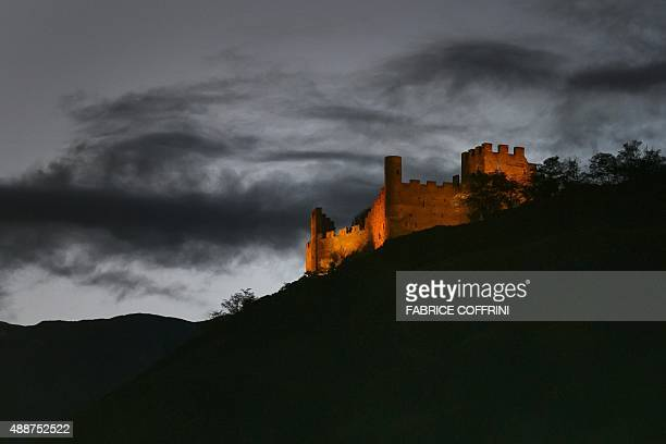 The castel of Tourbillon is seen at sunset in Sion Switzerland on September 17 2015 AFP PHOTO / FABRICE COFFRINI