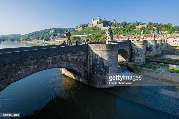 The castle 'Festung Marienberg' is located on a hill above the town the bridge 'Alte Mainbrücke' crossing the river Main