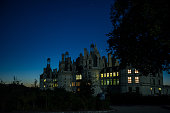The castle of Chambord is seen as the sun rises in Central France on September 29 2015 AFP PHOTO/GUILLAUME SOUVANT