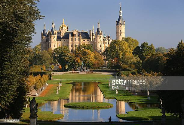 The castle Schwerin is pictured at the end of the autumnal castle gardens in Schwerin northern Germany on October 12 2012 The building serves as the...