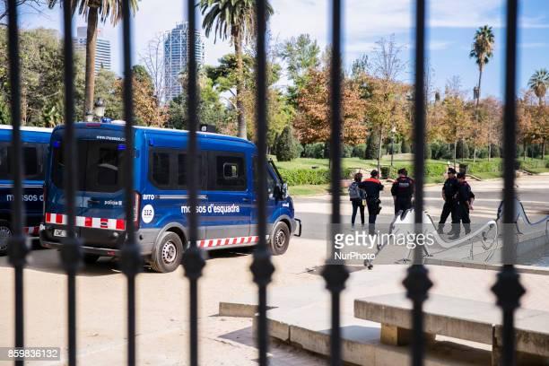 The Catalan Police Mossos d'Esquadra closes all the entrances to Ciutadella Park to ensure the Parliament is located Catalonia President Carles...